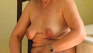X grandma probes her venerable pussy with a dildo