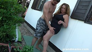 Obsessed with dealings granny enjoys sneaky dealings with young gardener