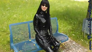 Fetish Lady Walking Outdoors In Sexy Shiny Outfits
